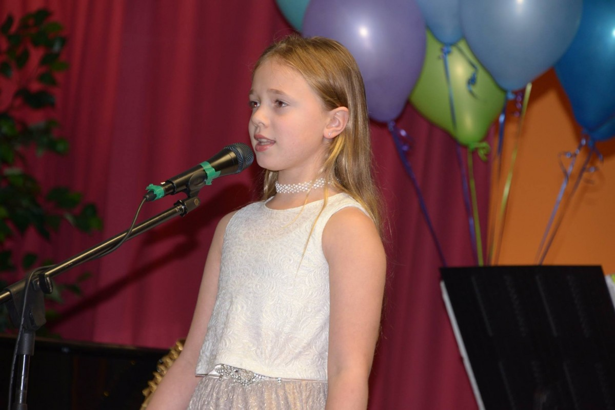A 5-year-old girl singing